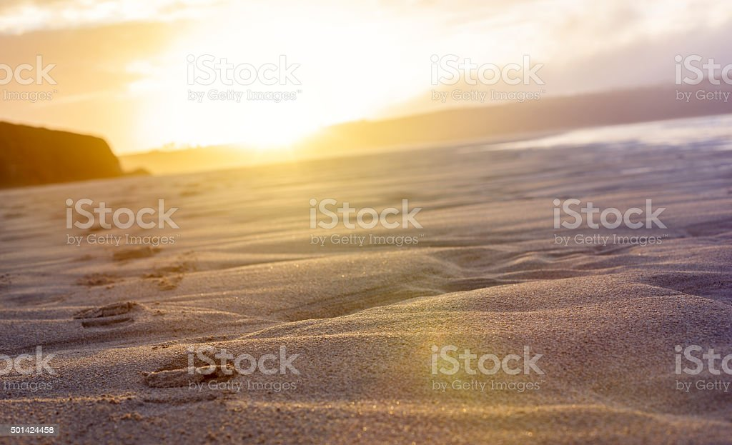 Beach footsteps into the sunlight, Cornwall stock photo