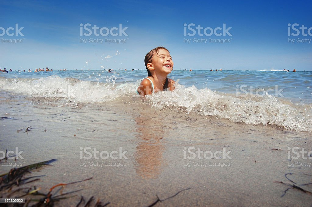 Beach frolicking fun in the surf royalty-free stock photo