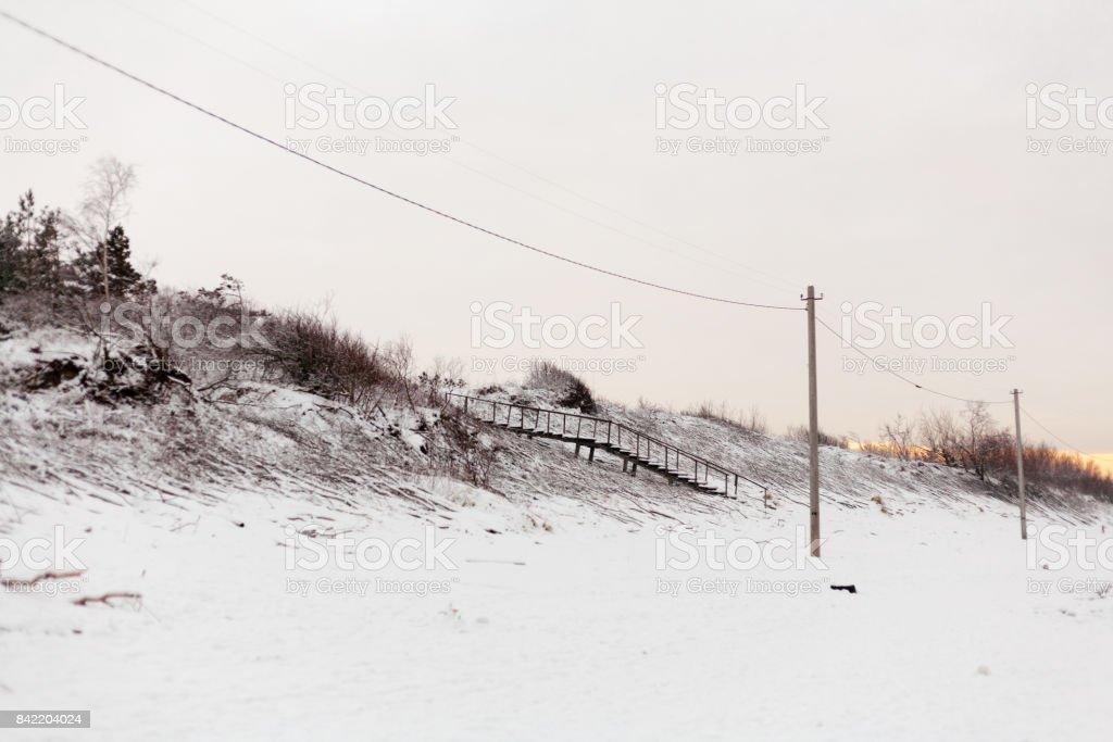 Beach frozen stream. Staircase. Winter landscape stock photo