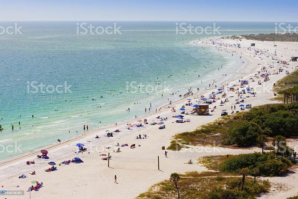 Beach goers on Lido Beach in Sarasota, FL stock photo