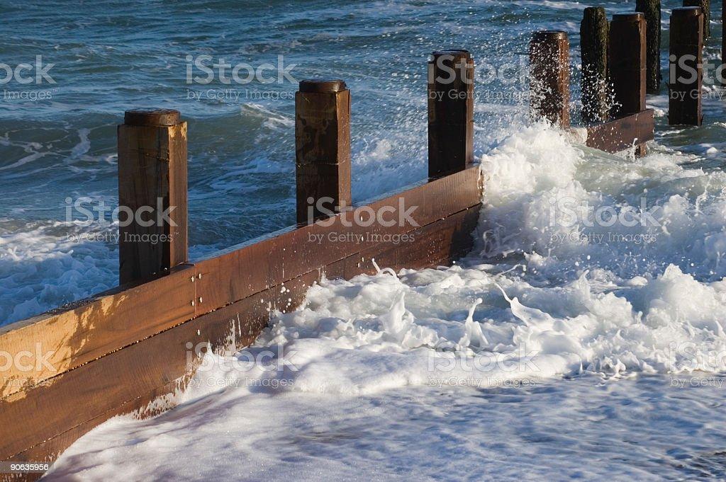 Beach Groynes With Surf stock photo