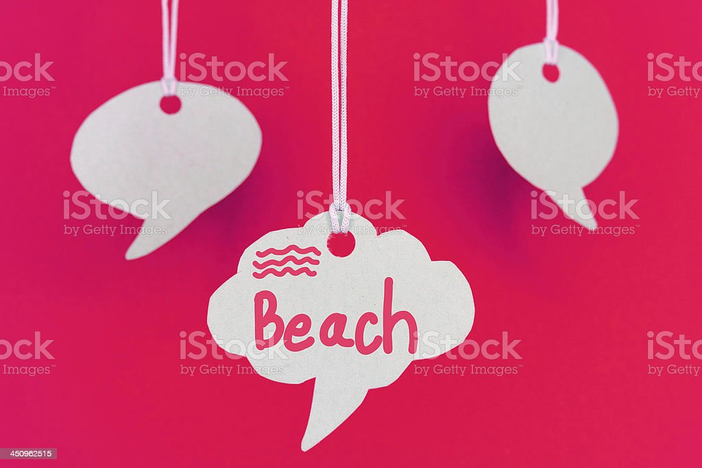 Beach hanging from string on red background royalty-free stock photo