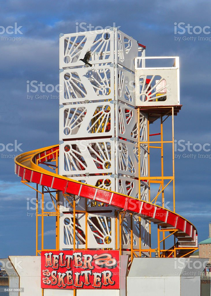 Beach helter skelter against a blue sky in Weymouth, Dorset stock photo