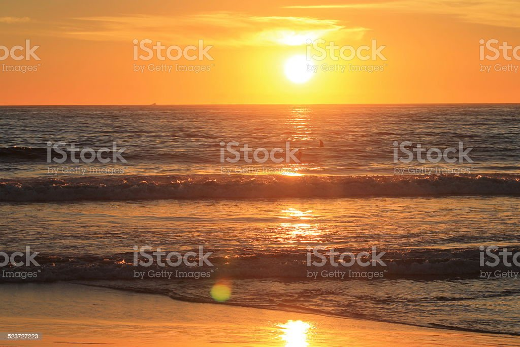 Beach Horizon at Sunset with Surfers stock photo