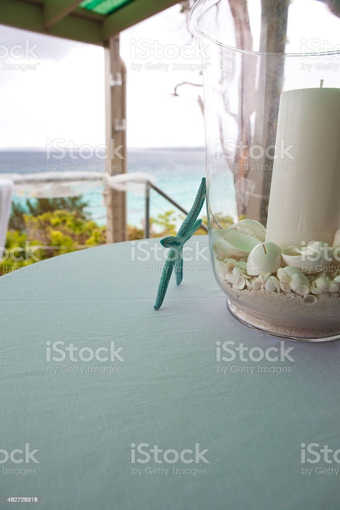 Beach House Table Setting with Starfish & Candle stock photo