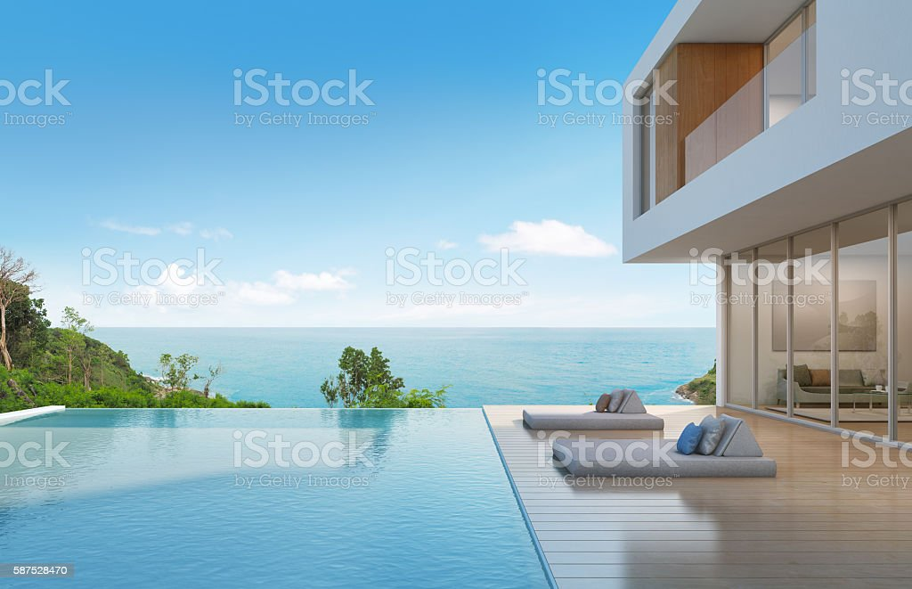 Beach house with pool in modern design stock photo