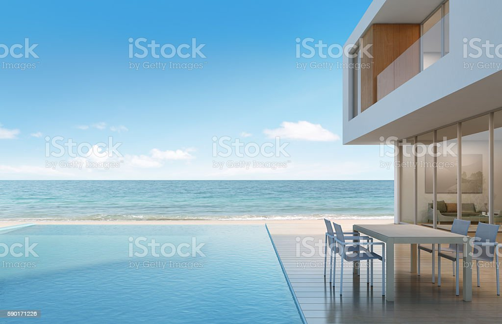 Beach house with sea view in modern design stock photo