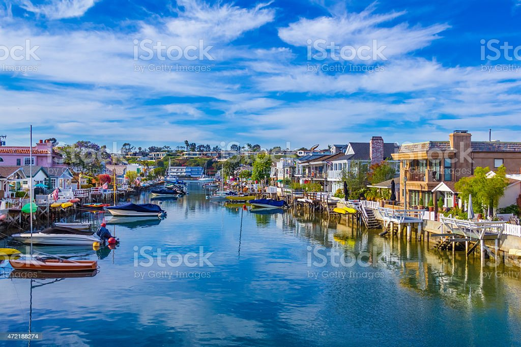 Beach houses and recreational boats at Newport Beach, CA (P) stock photo