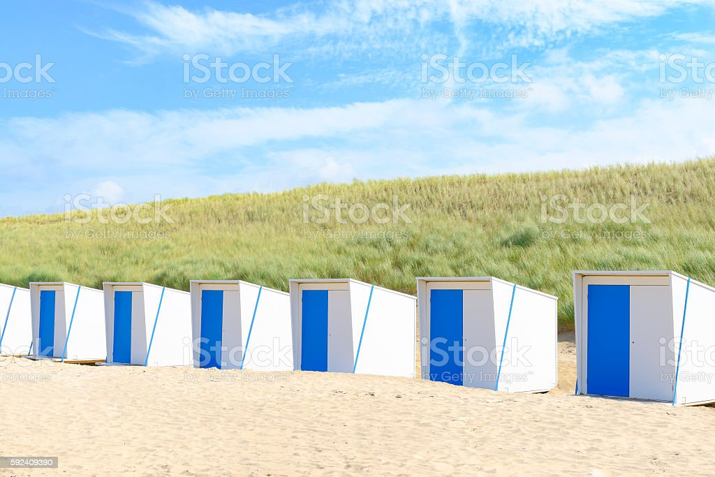 Beach houses on the beach in front of sand dunes stock photo