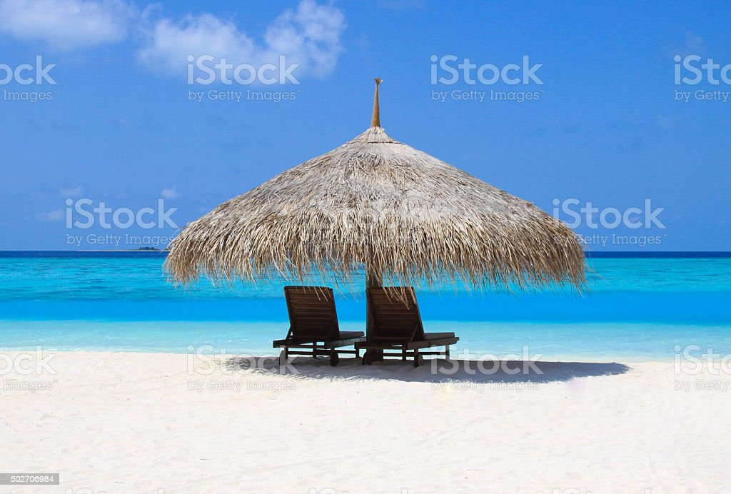 beach hut in the sun stock photo