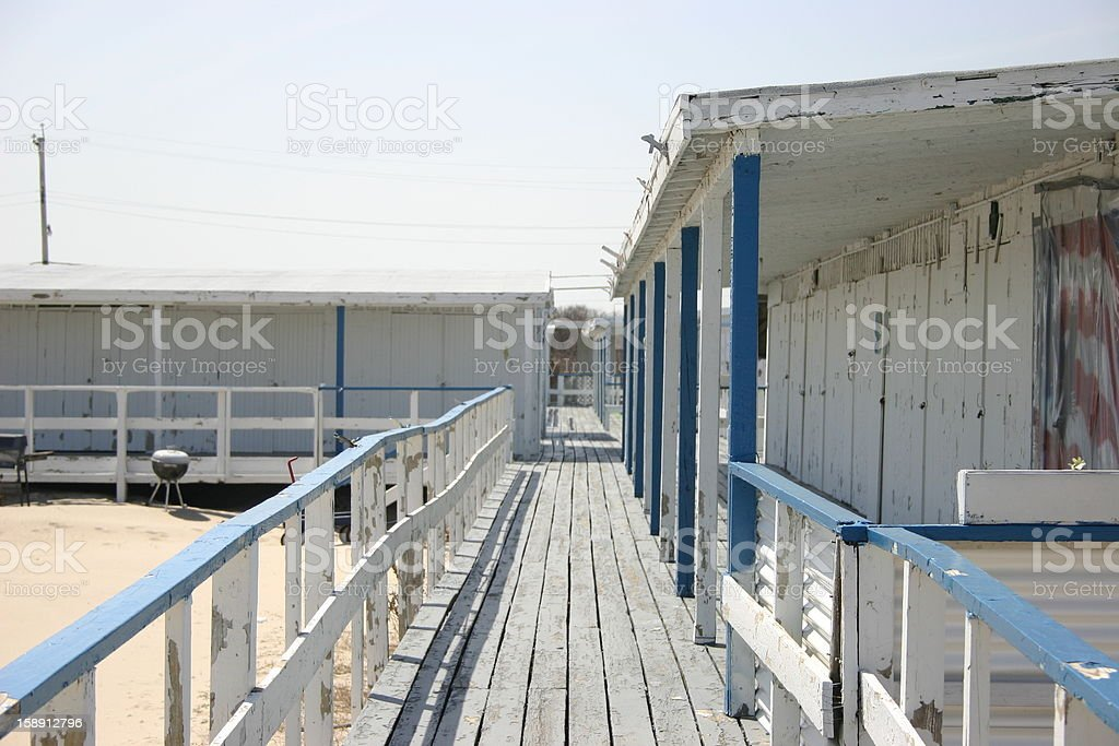 Beach Hut walkway and storage lockers royalty-free stock photo