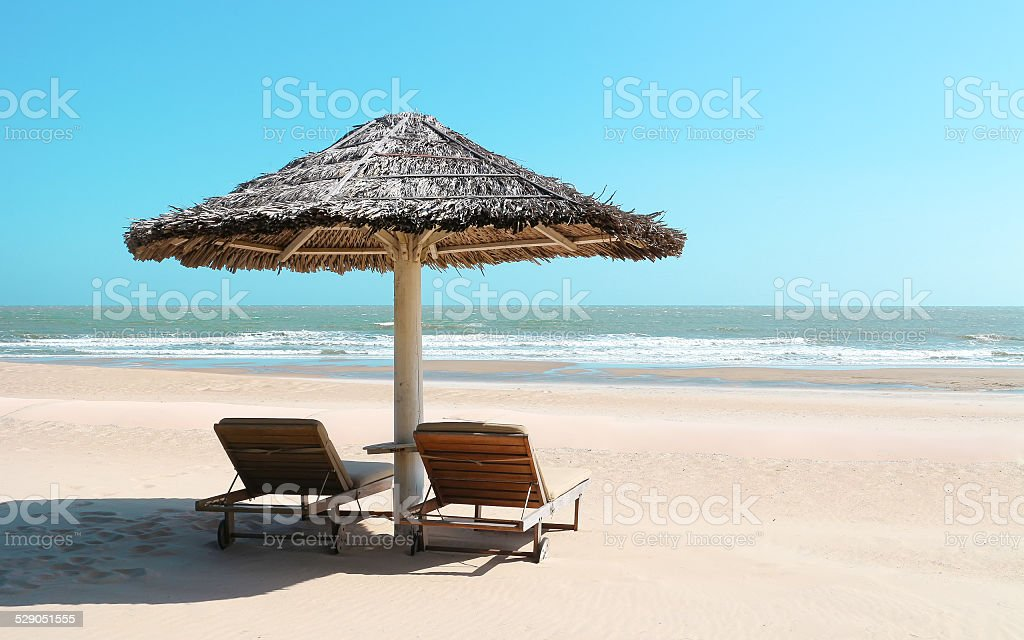 Beach hut with wooden chairs stock photo