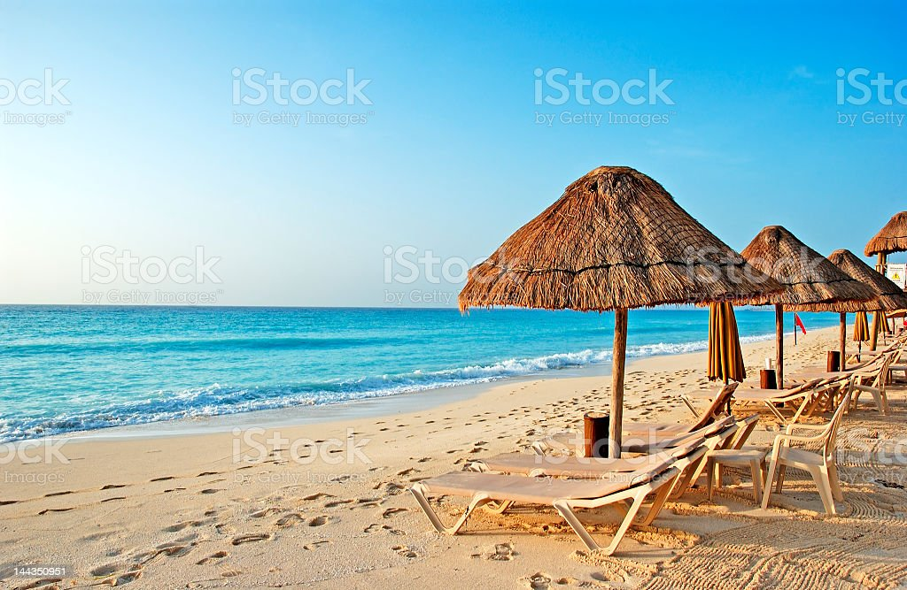 Beach huts and lounge chairs on Caribbean beach stock photo