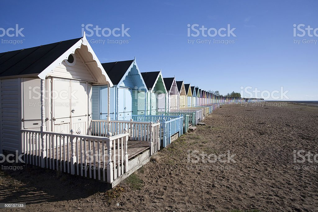 Beach Huts at West Mersea, Essex, England. stock photo