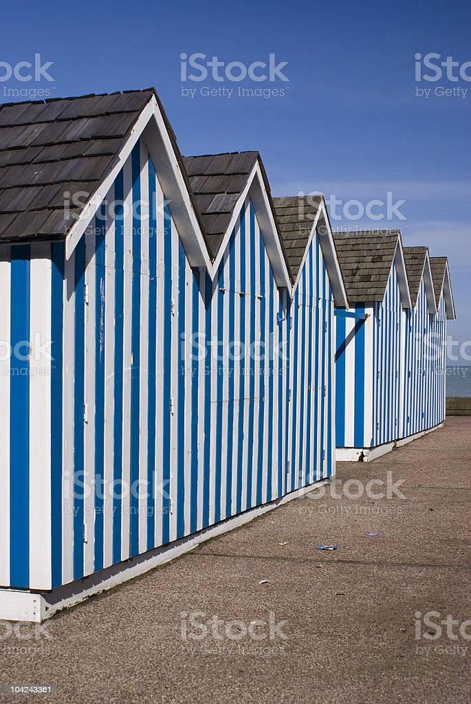 Beach Huts, Brightly coloured blue and white striped stock photo