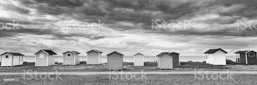 Beach huts in a row at Swedish beach stock photo