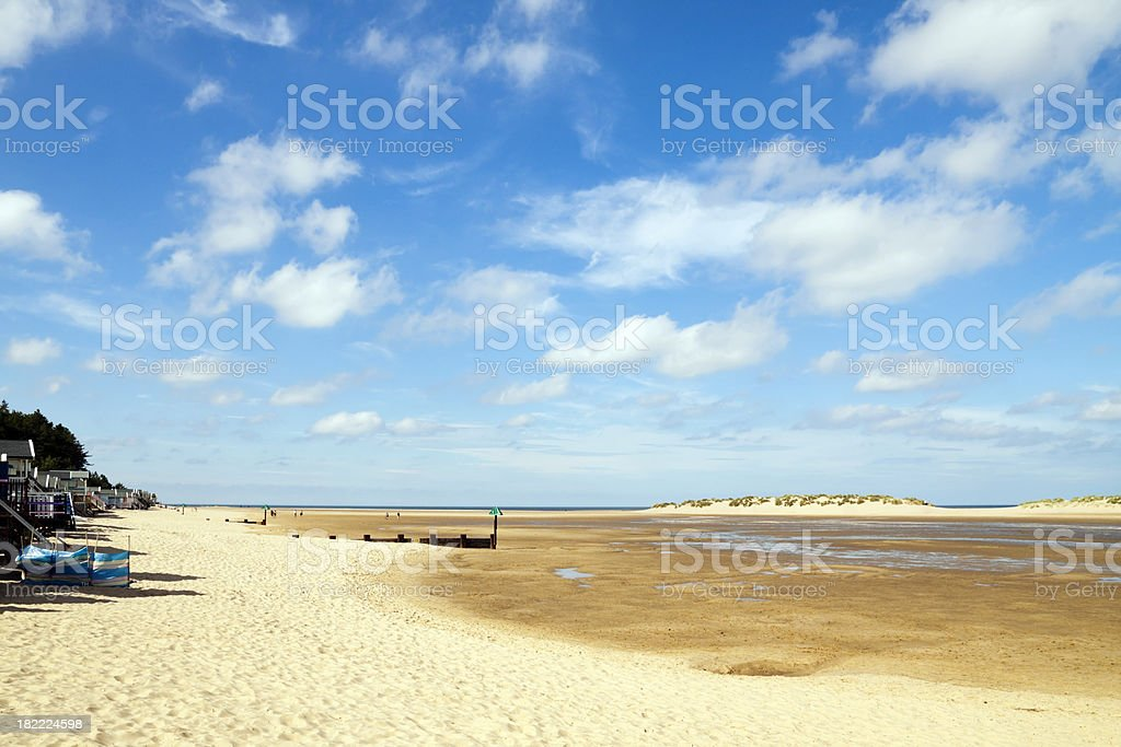 Beach huts, wide sands and big sky at Wells-next-the-Sea stock photo