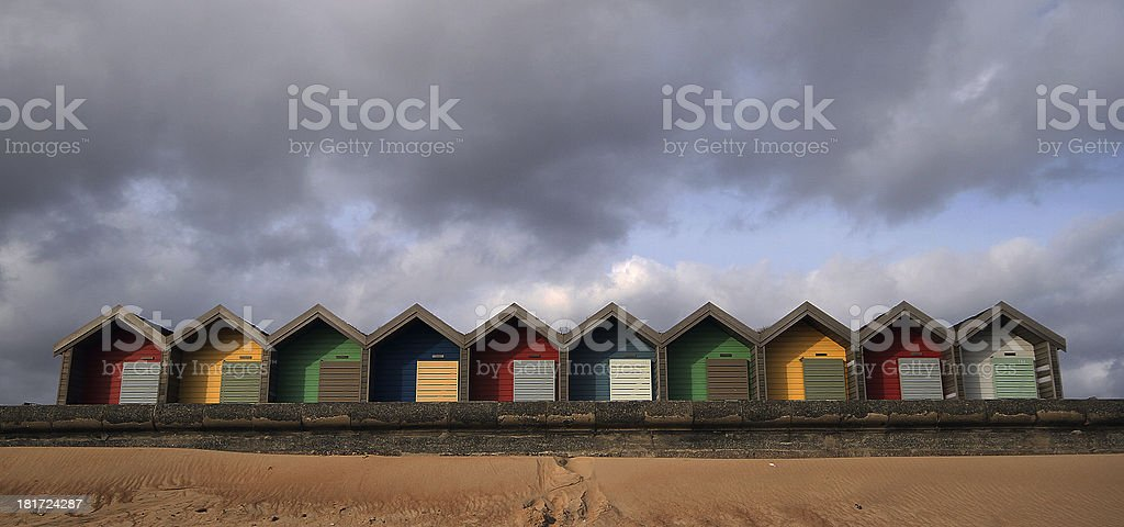 Beach Huts with clouds above royalty-free stock photo