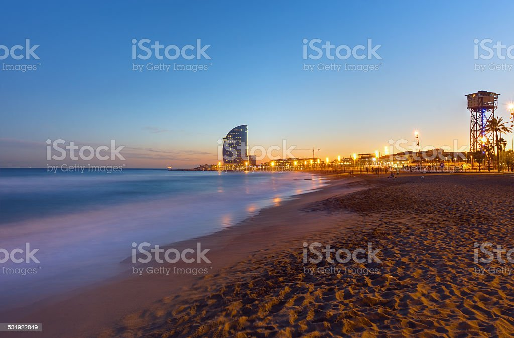 Beach in Barcelona at sunset stock photo