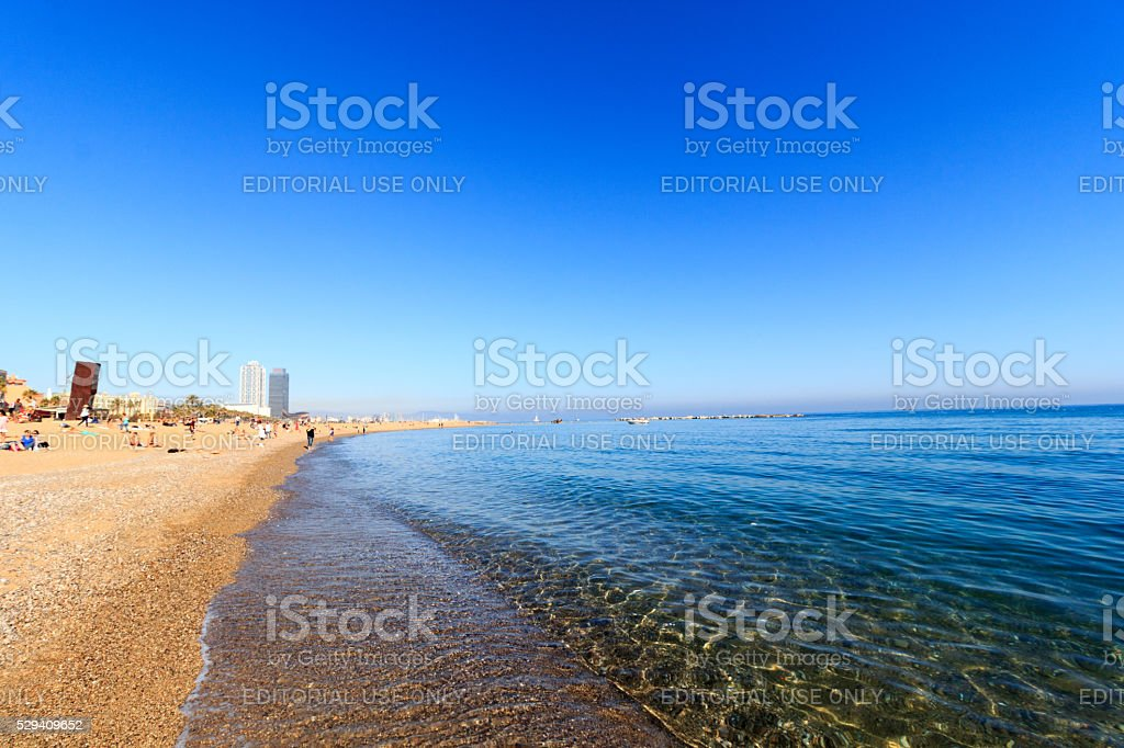 Beach in Barceloneta in Barcelona and blue sky, Spain stock photo