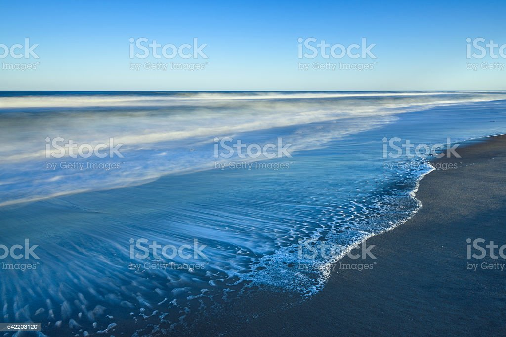 Beach in Late Afternoon Sun - Long Exposure stock photo