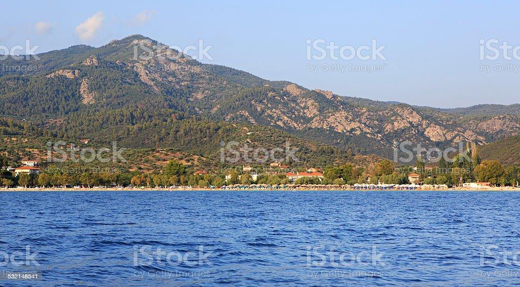Beach in Neos Marmaras and mountains of Sithonia. stock photo