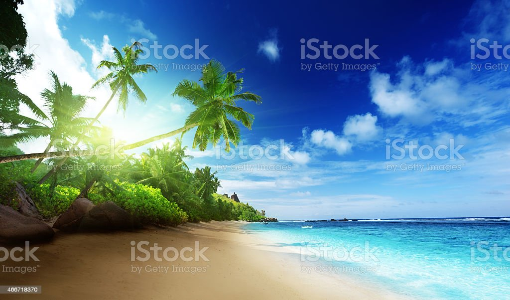 beach in sunset time on Mahe island in Seychelles stock photo