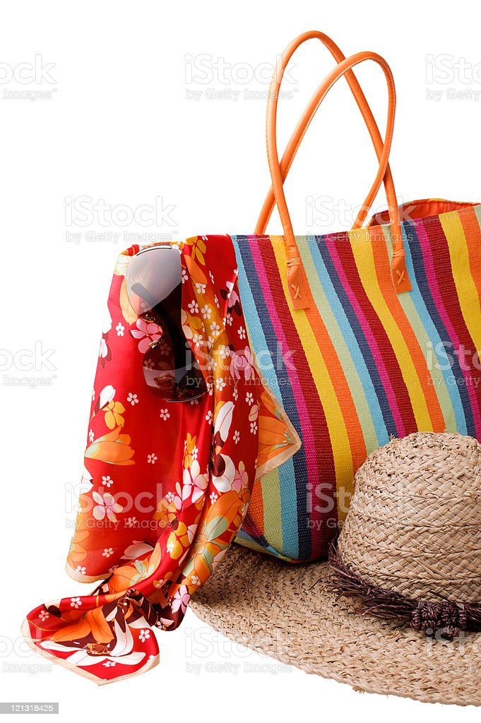 Beach items: colorful striped bag, bright kerchief, sunglasses a stock photo