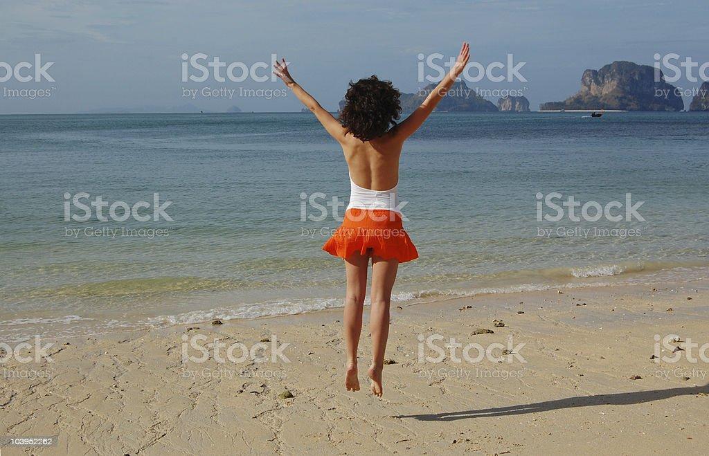 Beach jump stock photo