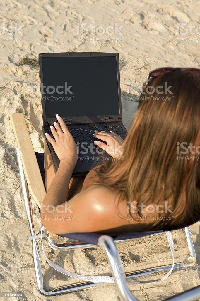 beach laptop stock photo