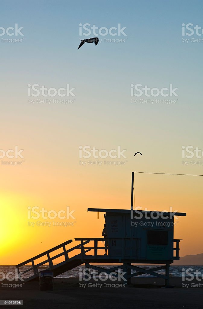 Beach lifeguard sunset royalty-free stock photo