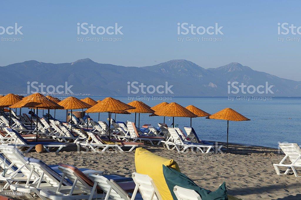 Beach loungers and umbrellas stock photo