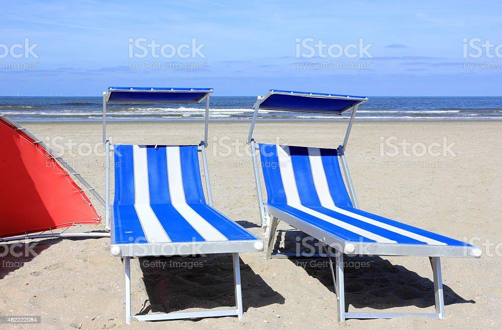 Beach loungers. Egmond aan Zee, North Sea, the Netherlands. stock photo