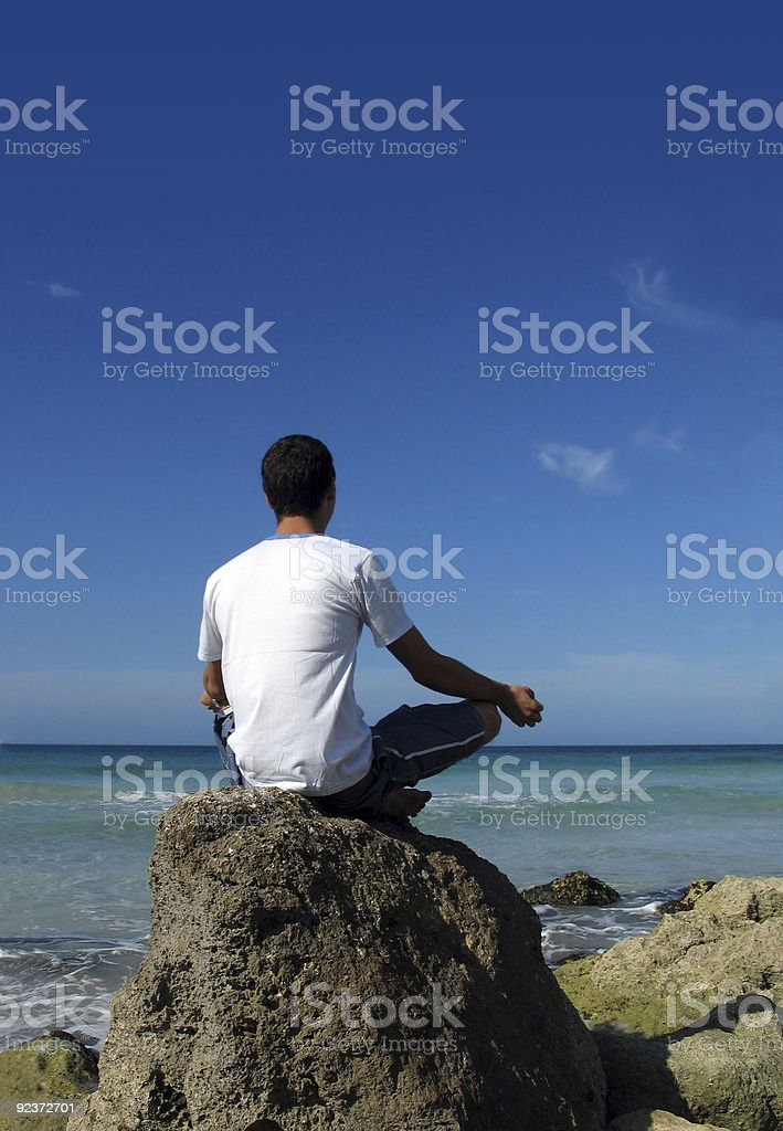 Beach meditation stock photo