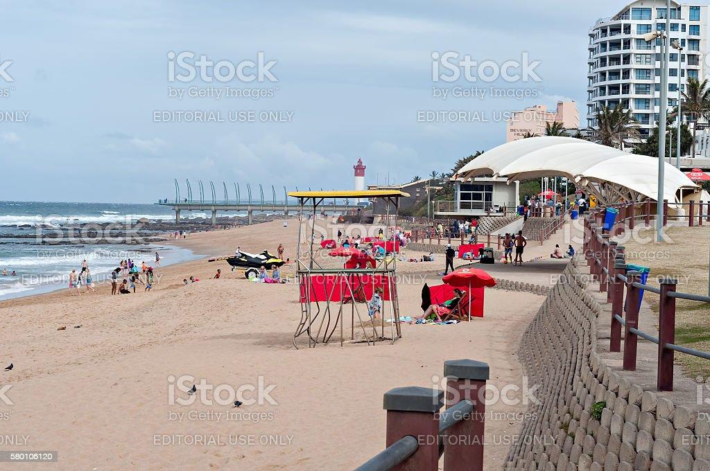 beach near the Millennium Pier and lighthouse in Umhlanga Rocks stock photo