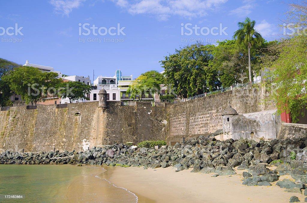 Beach next to Old San Juan Wall in Puerto Rico stock photo