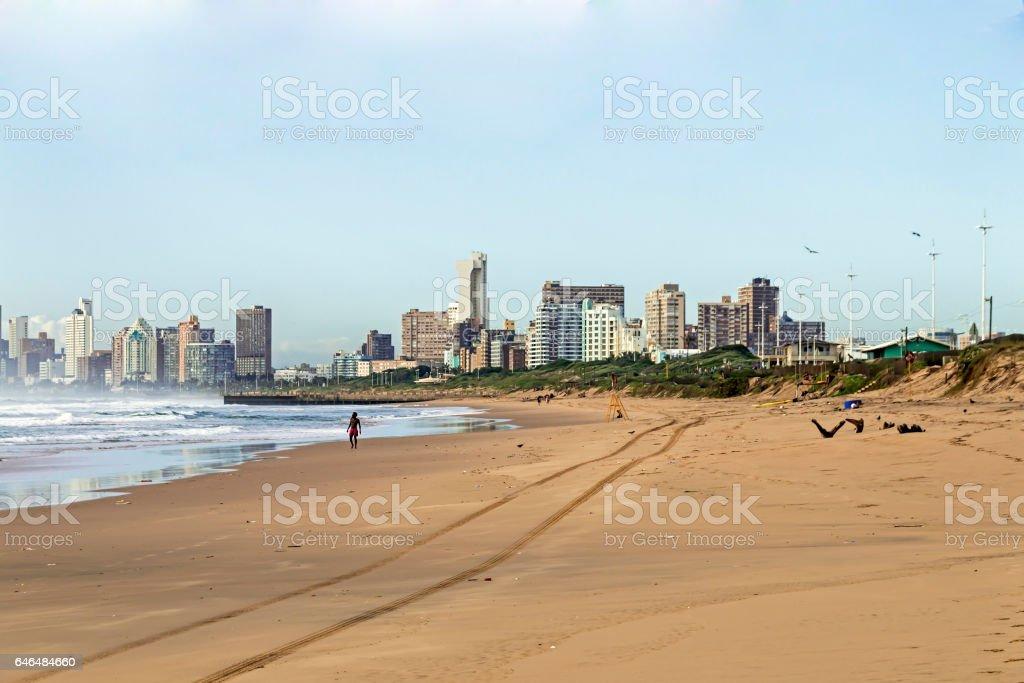 Beach ocean and waves against city Skyline stock photo