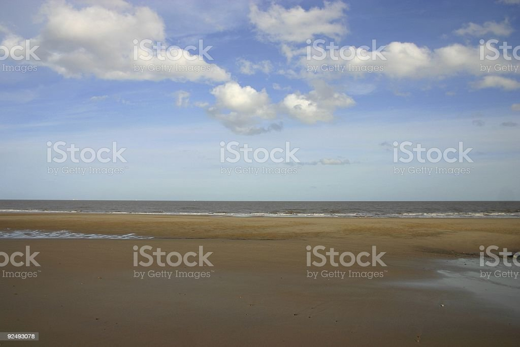 beach of golden sands and fluffy clouds royalty-free stock photo