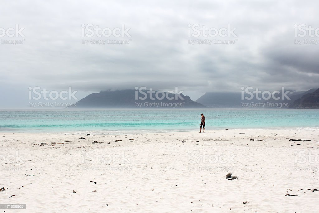 Beach of Kommetjie with an upcoming storm in the background stock photo