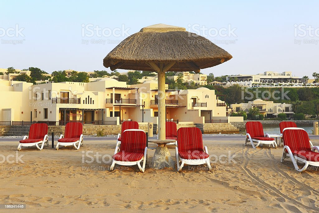 Beach of luxury hotel during sunset, Ras Al Khaima, UAE royalty-free stock photo