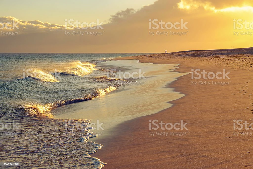 Beach of Morro Jable on Fuerteventura on the sunset. stock photo