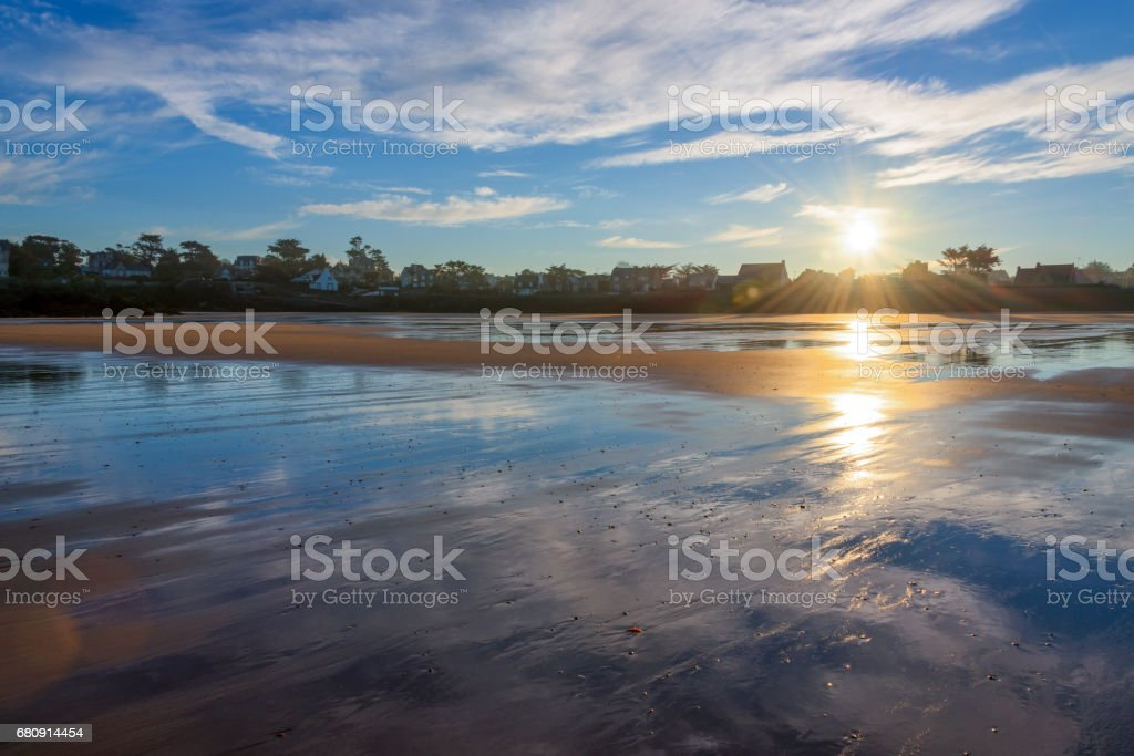 Beach of Saint Lunaire at low tide and sunrise, Brittany, France stock photo