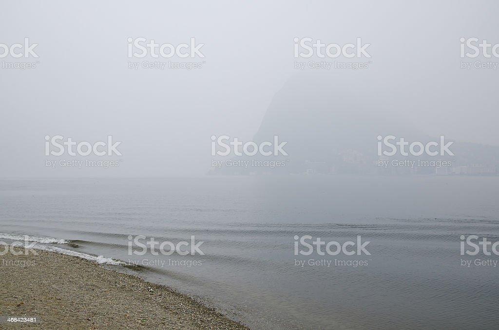 Beach on a foggy lake stock photo
