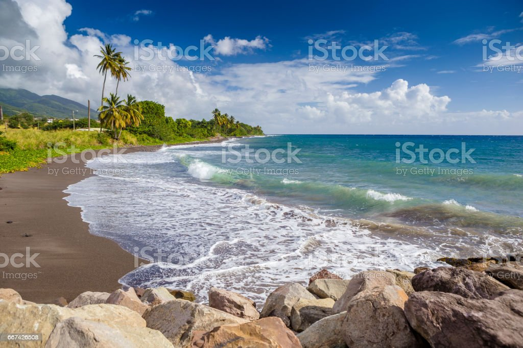 Beach on a St. Kitts island with black sand stock photo
