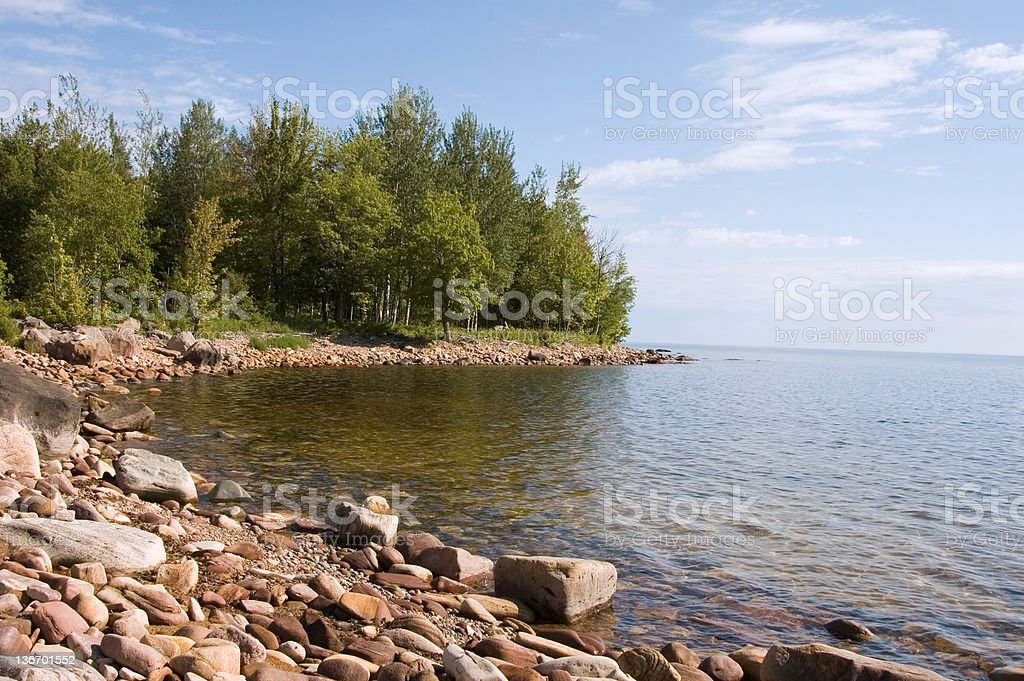 Beach on Rocky Lake Superior Shore, Michigan Great Lakes, USA royalty-free stock photo