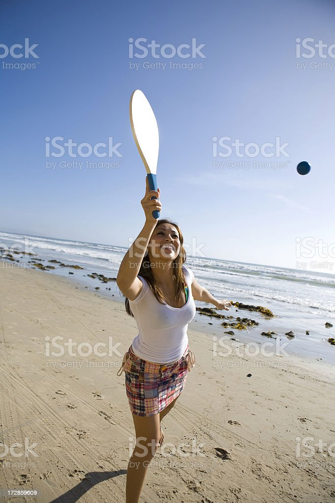 Beach Paddle Ball Female stock photo