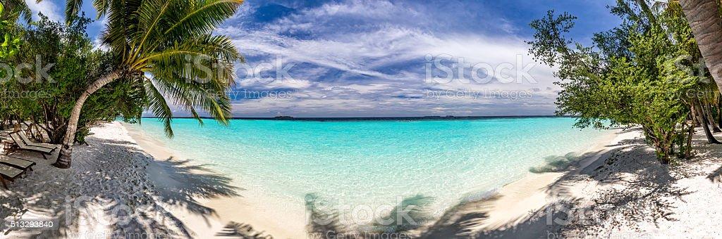 Beach panorama at Maldives stock photo