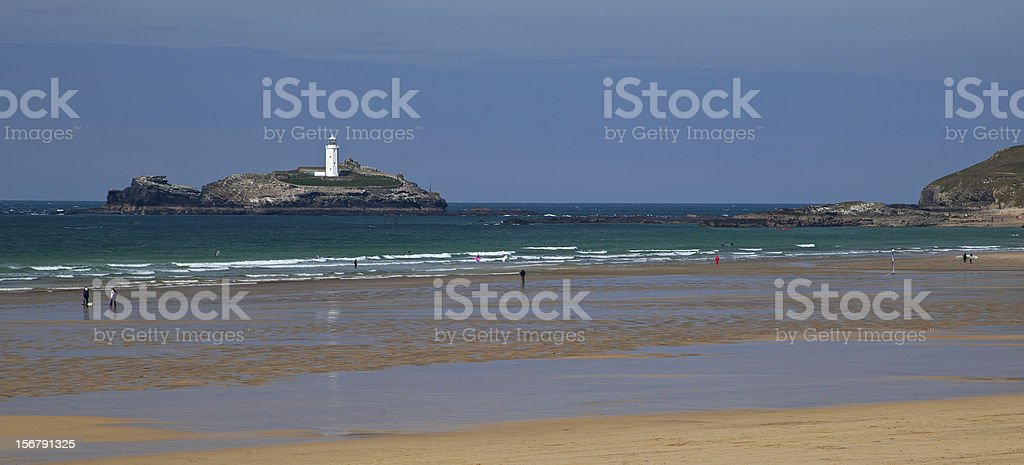 Beach Panorama - ocean and lighthouse at Godrevy, Cornwall stock photo
