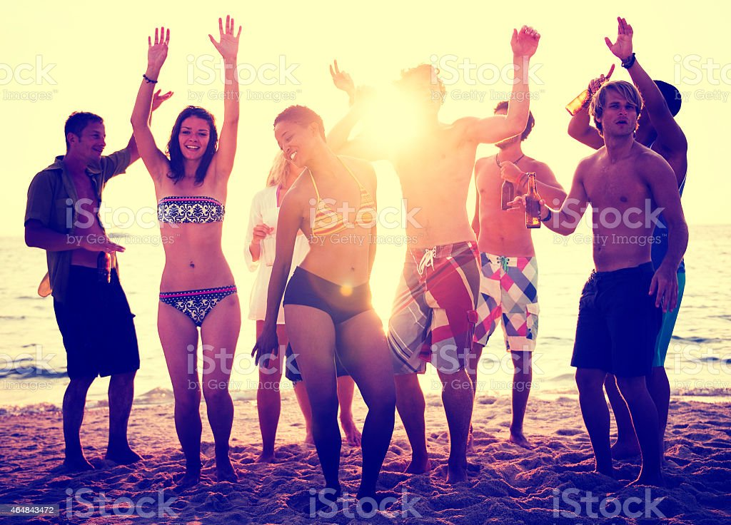 Beach Party Summer Dancing Sunset Freedom Concept stock photo