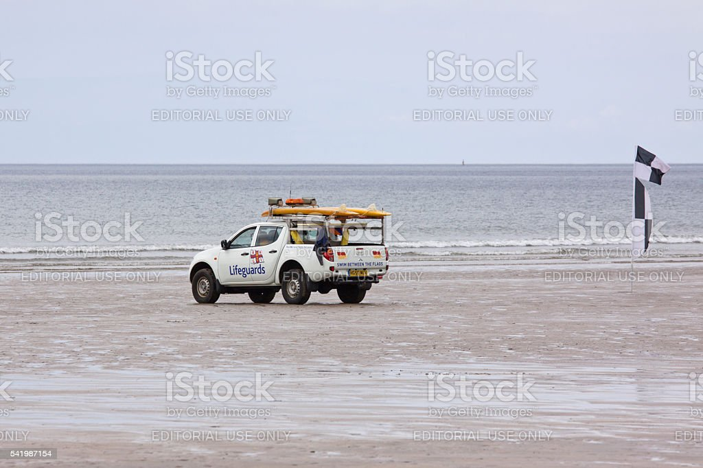 Beach patrol on the North Devon coast UK stock photo